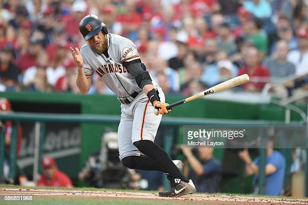 Hunter Pence of the San Francisco Giants reacts to foul tip that went off his face in the second inning during a baseball game against the Washington...