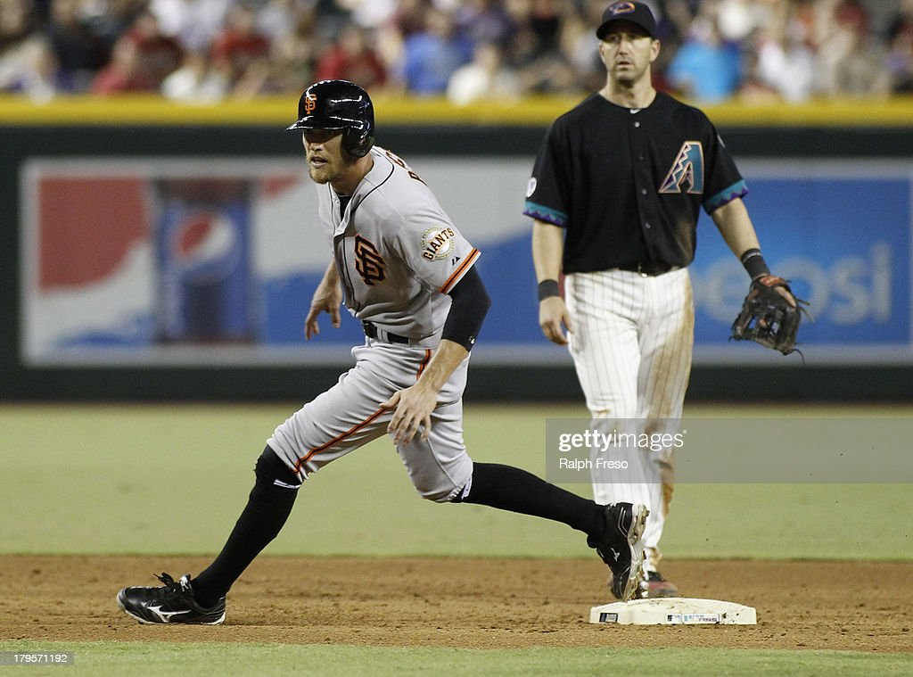 <a gi-track='captionPersonalityLinkClicked' href=/galleries/search?phrase=Hunter+Pence&family=editorial&specificpeople=757341 ng-click='$event.stopPropagation()'>Hunter Pence</a> #8 of the San Francisco Giants rounds second base during the sixth inning of a MLB game at Chase Field on August 31, 2013 in Phoenix, Arizona.