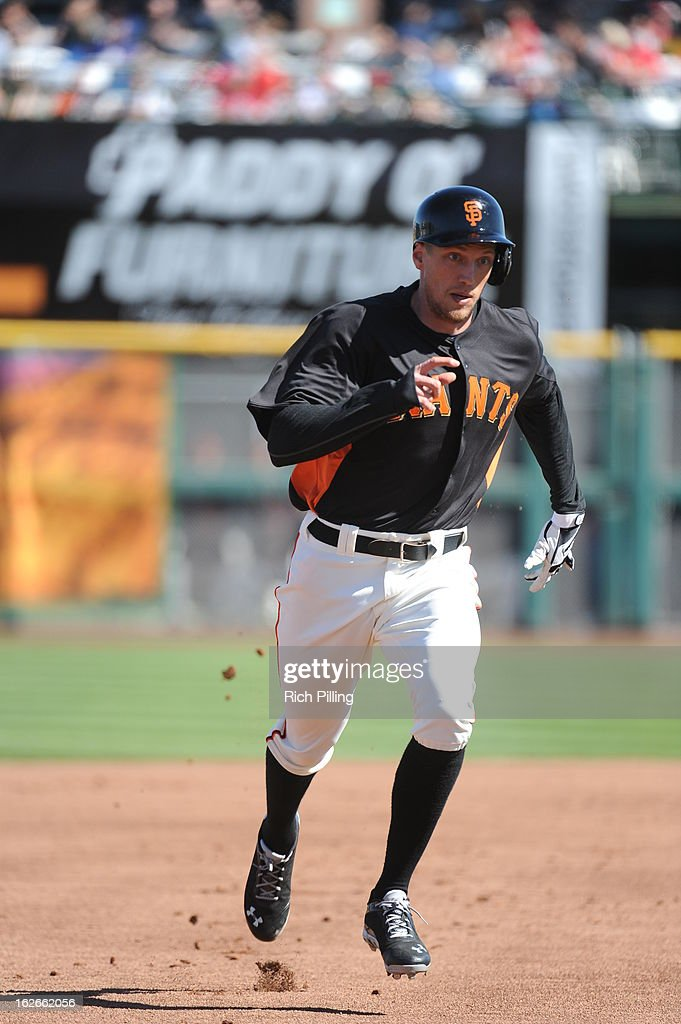 <a gi-track='captionPersonalityLinkClicked' href=/galleries/search?phrase=Hunter+Pence&family=editorial&specificpeople=757341 ng-click='$event.stopPropagation()'>Hunter Pence</a> #8 of the San Francisco Giants runs during the game against the Chicago White Sox on February 25, 2013 at Scottsdale Stadium in Scottsdale, Arizona. The Giants and White Sox played to a 9-9 tie.