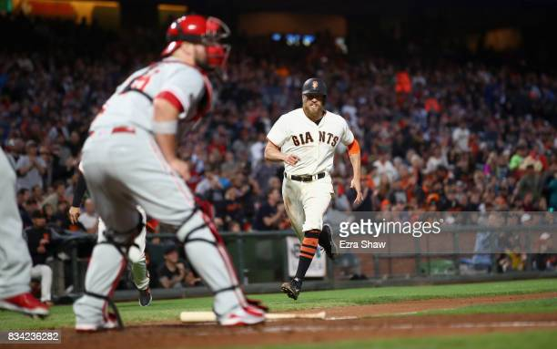 Hunter Pence of the San Francisco Giants runs home to score in the third inning against the Philadelphia Phillies at ATT Park on August 17 2017 in...