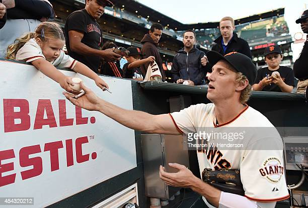 Hunter Pence of the San Francisco Giants signs autographs for fans prior to the start of the game against the Colorado Rockies at ATT Park on August...