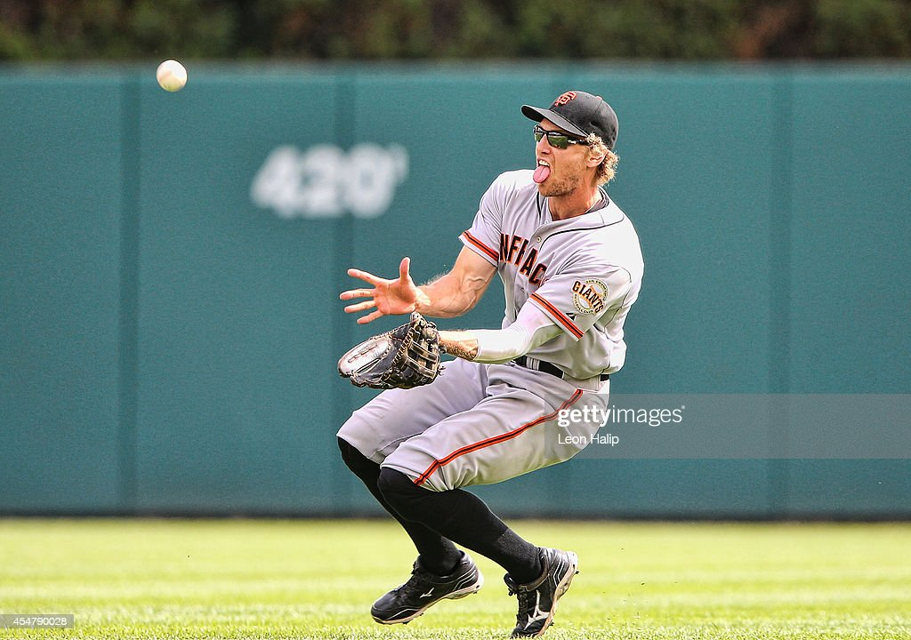 <a gi-track='captionPersonalityLinkClicked' href=/galleries/search?phrase=Hunter+Pence&family=editorial&specificpeople=757341 ng-click='$event.stopPropagation()'>Hunter Pence</a> #8 of the San Francisco Giants slides to make the catch on the line drive from Rajai Davis (not in photo) of the Detroit Tigers during the seventh inning of the game at Comerica Park on September 6, 2014 in Detroit, Michigan. The Giants defeated the Tigers 5-4.