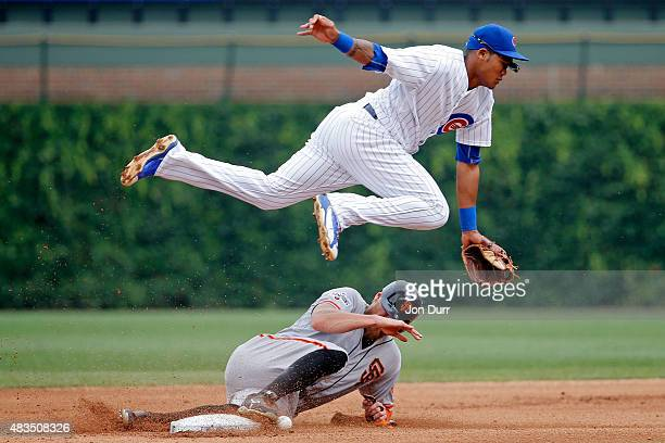 Hunter Pence of the San Francisco Giants steals second base as Addison Russell of the Chicago Cubs covers during the fourth inning at Wrigley Field...