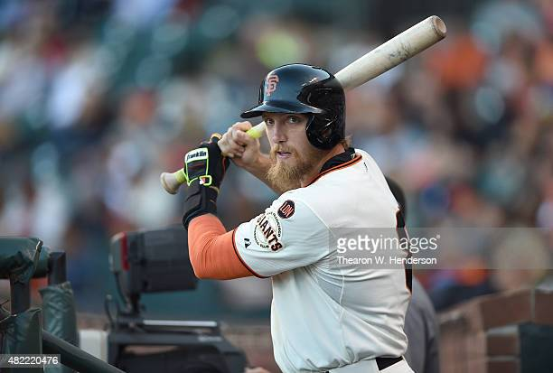 Hunter Pence of the San Francisco Giants warms up his swing while standing on the dugout steps in the bottom of the first inning against the...