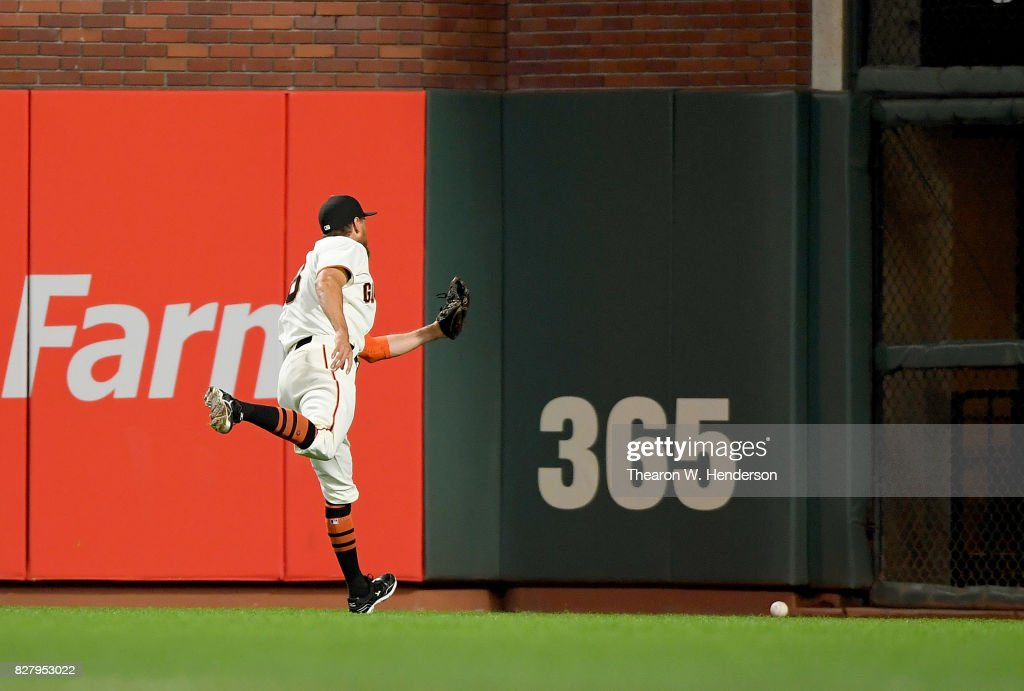 Hunter Pence #8 of the San Francisco Giants watches a ball go over his head for a double off the bat of Willson Contreras #40 of the Chicago Cubs in the top of the six inning at AT&T Park on August 8, 2017 in San Francisco, California.