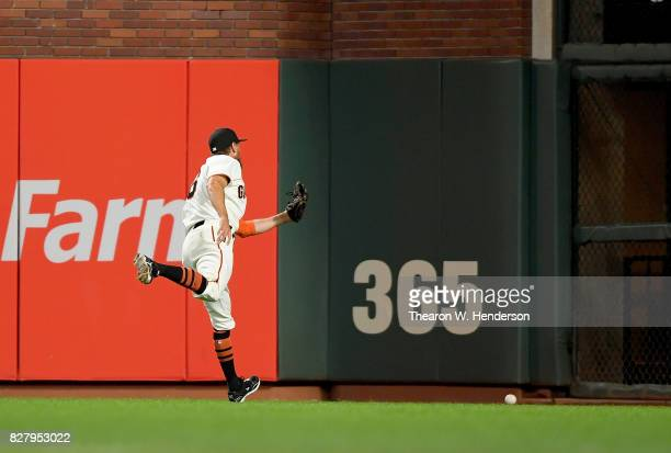 Hunter Pence of the San Francisco Giants watches a ball go over his head for a double off the bat of Willson Contreras of the Chicago Cubs in the top...