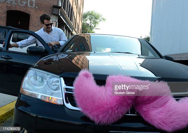 Hunter Perry a regular Lyft user gets picked up on July 16 2013 near his office on Harrison Avenue The vehicles participating in the Lyft program...