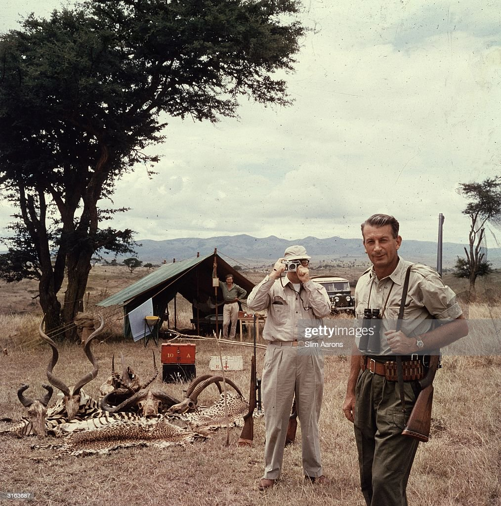Hunter Reggie Destro, right, and famous and innovative photographer Arnold Newman with a collection of wild animal 'trophies' in the countryside outside Nairobi, Kenya.