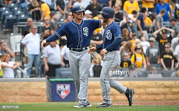 Hunter Renfroe of the San Diego Padres and Matt Szczur celebrate after coming around to score on a two run single by Manuel Margot in the ninth...