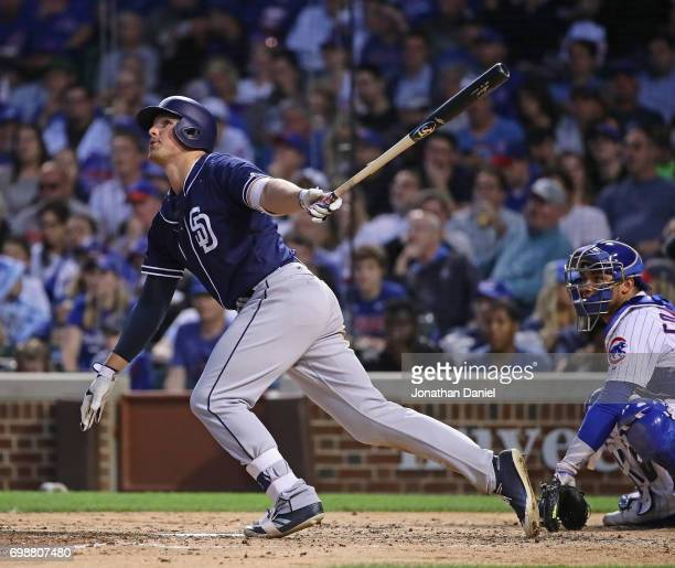 Hunter Renfroe of the San Diego Padres bats against the Chicago Cubs at Wrigley Field on June 19 2017 in Chicago Illinois The Cubs defeated the...