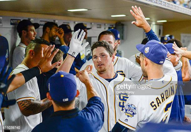 Hunter Renfroe of the San Diego Padres center is congratulated in the dugout after hitting a tworun home run during the third inning of a baseball...
