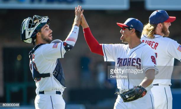 Hunter Renfroe of the San Diego Padres high fives Austin Hedges after beating the Los Angeles Dodgers 53 in a baseball game at PETCO Park on July 2...
