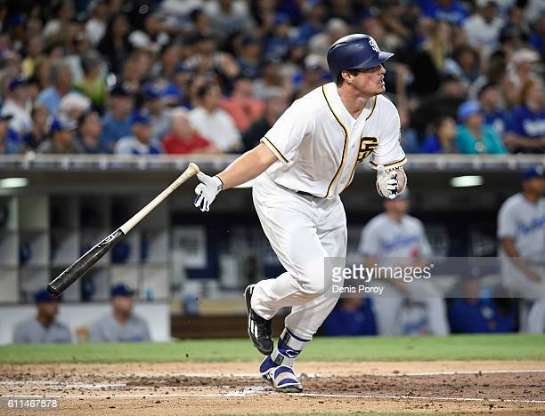 Hunter Renfroe of the San Diego Padres hits a single during the fourth inning of a baseball game against the Los Angeles Dodgers at PETCO Park on...