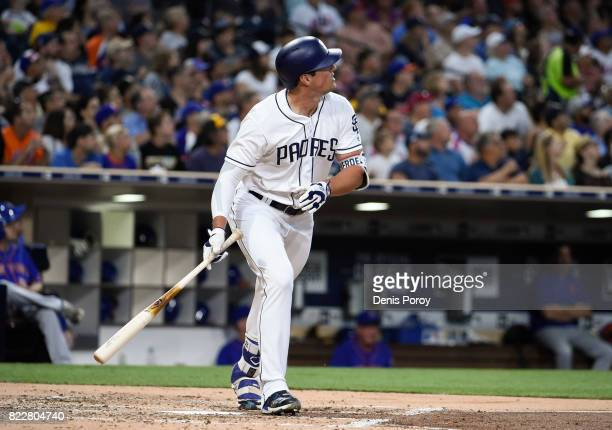 Hunter Renfroe of the San Diego Padres hits a solo home run during the second inning of a baseball game against the New York Mets at PETCO Park on...