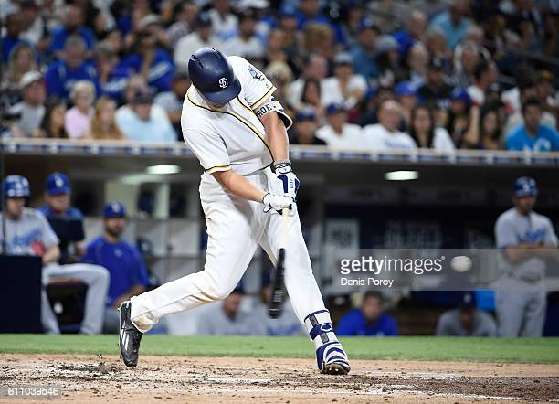 Hunter Renfroe of the San Diego Padres hits a tworun home run during the third inning of a baseball game against the Los Angeles Dodgers at PETCO...