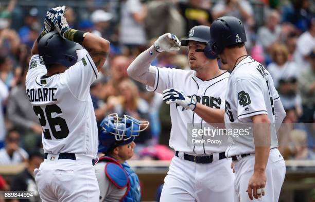 Hunter Renfroe of the San Diego Padres is congratulated by Yangervis Solarte and Wil Myers after hitting a grand slam during the fourth inning of a...