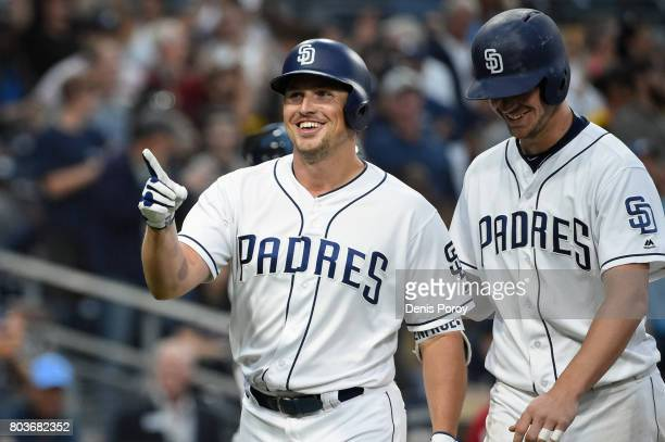 Hunter Renfroe of the San Diego Padres left celebrates with Wil Myers after hitting a tworun home run during the fifth inning of a baseball game...