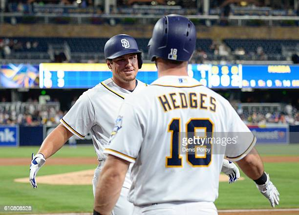 Hunter Renfroe of the San Diego Padres left is congratulated by Austin Hedges after hitting a threerun home run during the first inning of a baseball...