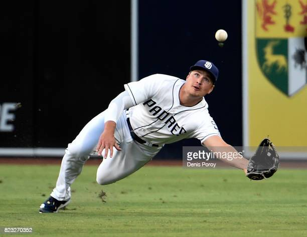 Hunter Renfroe of the San Diego Padres makes a diving catch on a ball hit by Yoenis Cespedes of the New York Mets during the first inning of a...