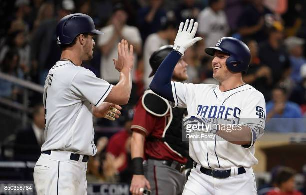 Hunter Renfroe of the San Diego Padres right is congratulated by Wil Myers after hitting a tworun home run during the third inning of a baseball game...