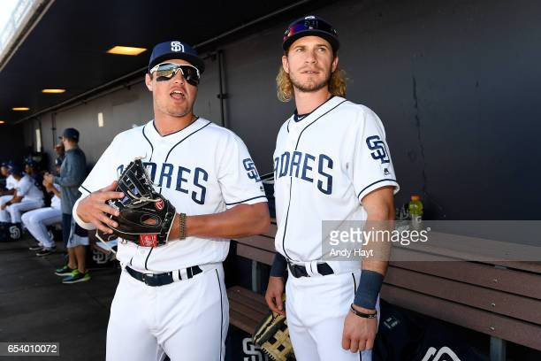 Hunter Renfroe talks with Travis Jankowski of the San Diego Padres prior to the spring training game against the Cleveland Indians at the Peoria...