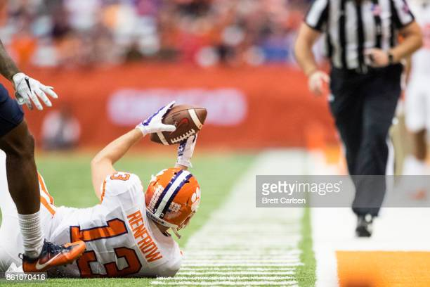 Hunter Renfrow of the Clemson Tigers displays a diving catch to the referee during the second half against the Syracuse Orange at the Carrier Dome on...