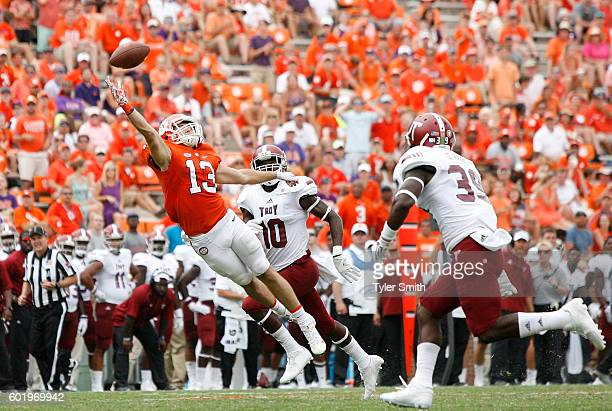Hunter Renfrow of the Clemson Tigers reaches for a pass during the game against the Troy Trojans at Memorial Stadium on September 10 2016 in Clemson...