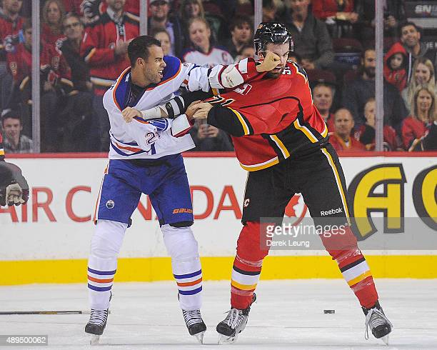 Hunter Smith of the Calgary Flames fights Darnell Nurse of the Edmonton Oilers during a preseason NHL game at Scotiabank Saddledome on September 21...
