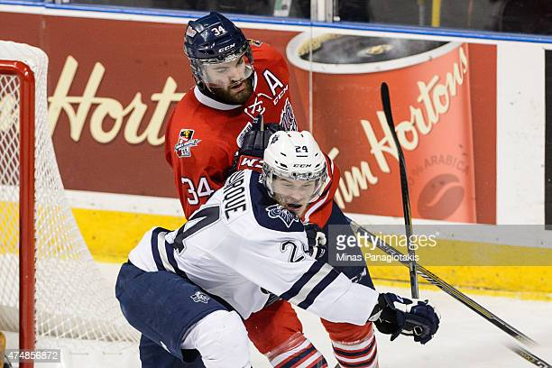 Hunter Smith of the Oshawa Generals holds onto Simon Bourque of the Rimouski Oceanic in Game Two during the 2015 Memorial Cup at the Pepsi Coliseum...