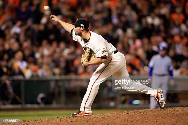 Hunter Strickland of the San Francisco Giants pitches in the ninth inning while taking on the Kansas City Royals during Game Four of the 2014 World...