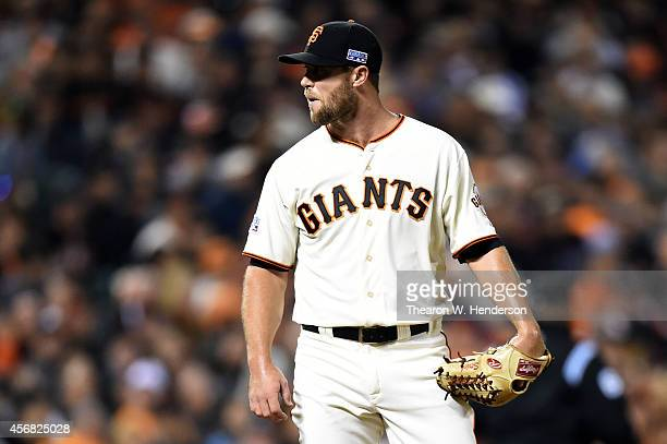 Hunter Strickland of the San Francisco Giants reacts after Bryce Harper of the Washington Nationals hit a home run in the seventh inning during Game...