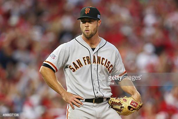 Hunter Strickland of the San Francisco Giants reacts after giving up a home run to Asdrubal Cabrera of the Washington Nationals in the seventh inning...