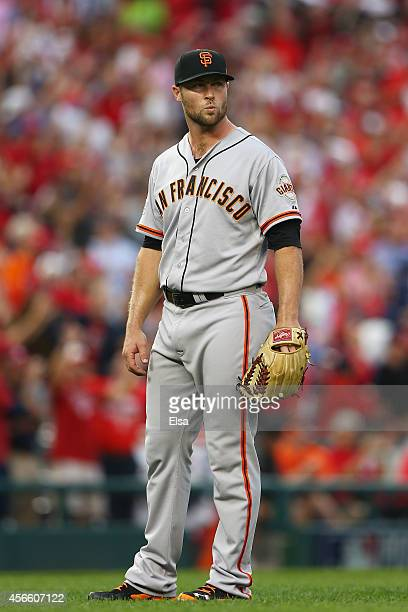 Hunter Strickland of the San Francisco Giants reacts after giving up a home run to Bryce Harper of the Washington Nationals in the seventh inning...