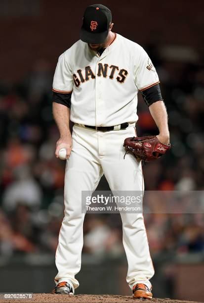 Hunter Strickland of the San Francisco Giants shows a split finger fastball grip against the Washington Nationals in the top of the eighth inning at...