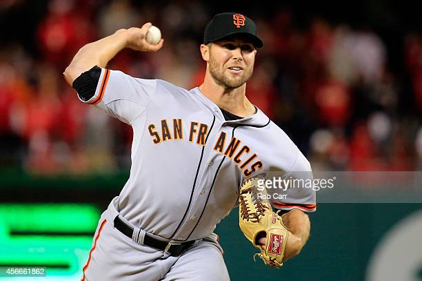 Hunter Strickland of the San Francisco Giants throws a pitch in the eighteenth inning against the Washington Nationals during Game Two of the...