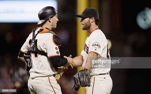 Hunter Strickland shakes hands with Trevor Brown of the San Francisco Giants after they beat the Boston Red Sox at ATT Park on June 8 2016 in San...