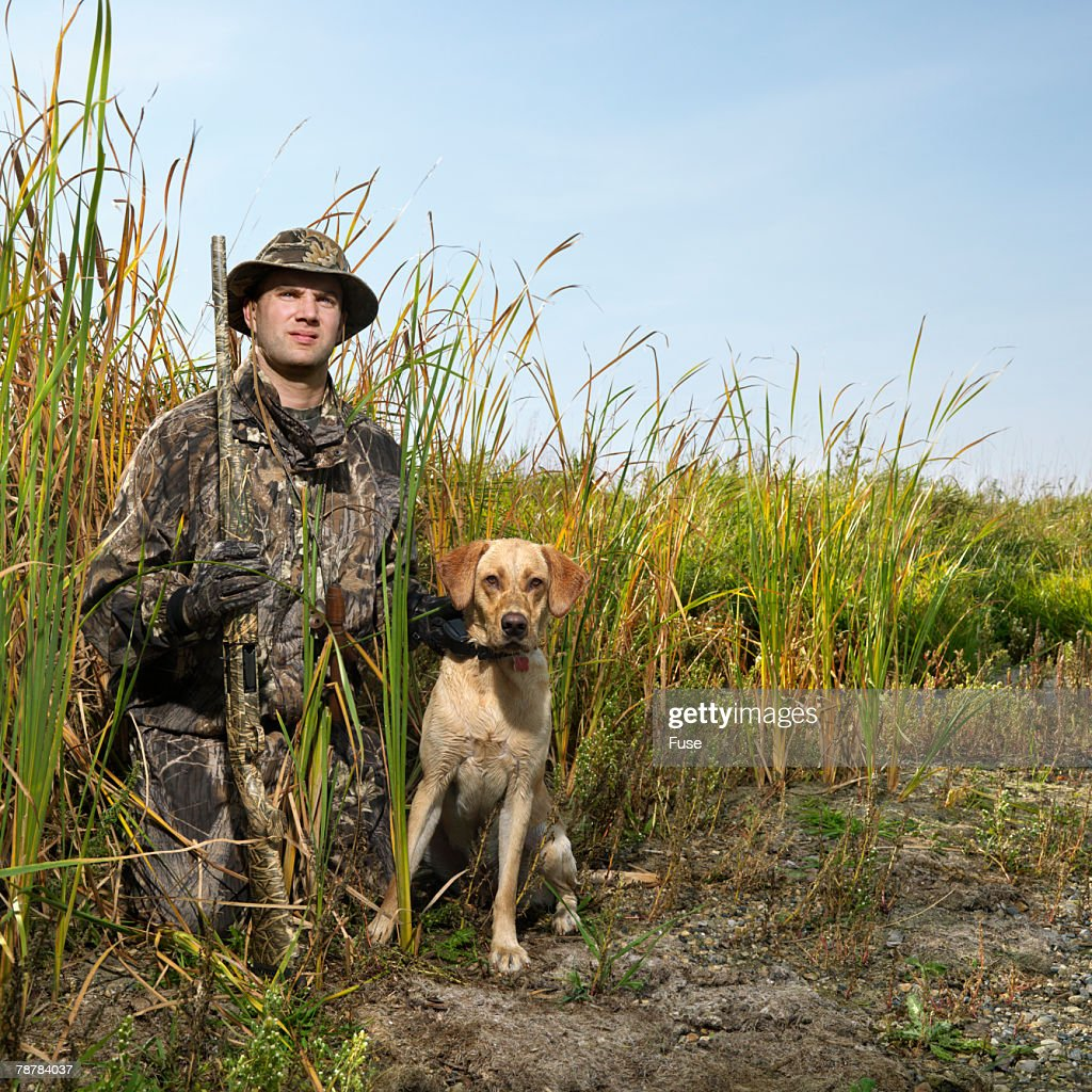 Hunter with Dog in Reeds