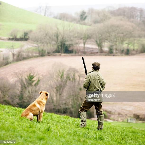 Jäger mit seinem Hund