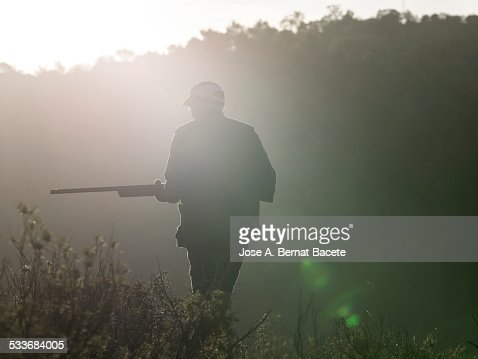 Hunter with his weapon in the mountain