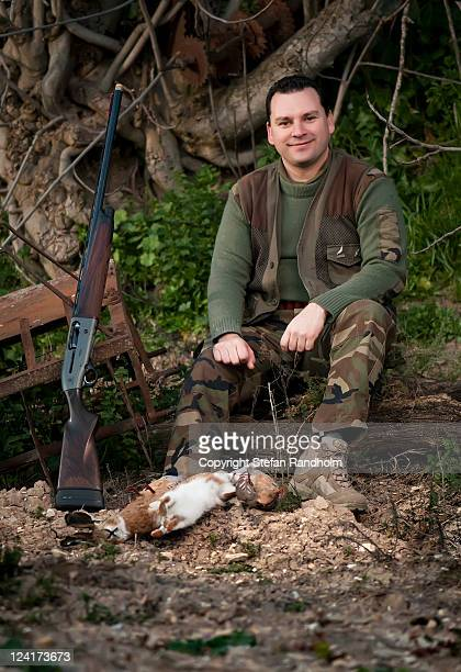 Hunter with rifle and shot prey