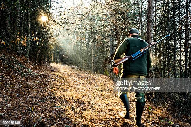 Hunter with rifle in the woods