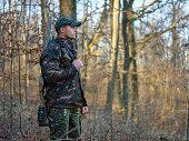 Hunter in camo suit with double barrel shotgun