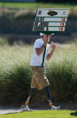 Hunter Woodhall of Utah walks with a standard on the third hole during the final round of the Justin Timberlake Shriners Hospitals for Children Open...