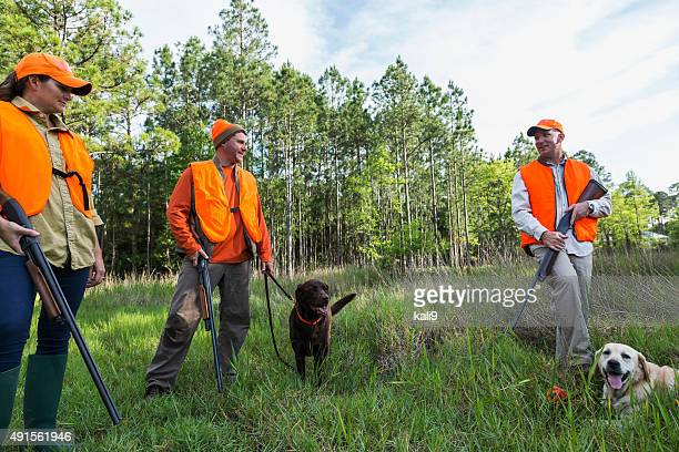 Hunters with hunting dogs
