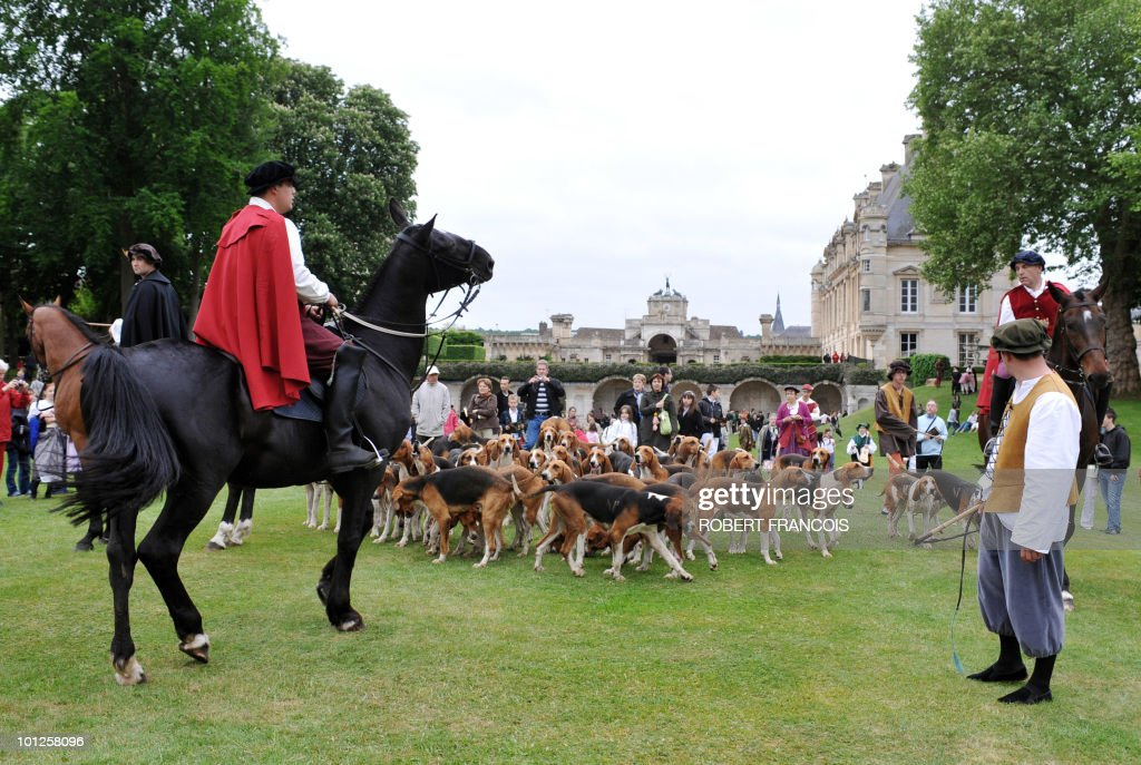 A hunting crew takes part in a 'Renaissance day' at the Chateau d'Anet, central France, on May 29, 2010, as part of the celebration of the return of Diane de Poitier�s remains in the chateau. King Henri II's mistress Diane de Poitiers died in 1566 at the age of 66 and was buried in the funeral chapel of her chateau. Her grave was opened during the French Revolution and her remains were discovered in a mass grave in 2008.