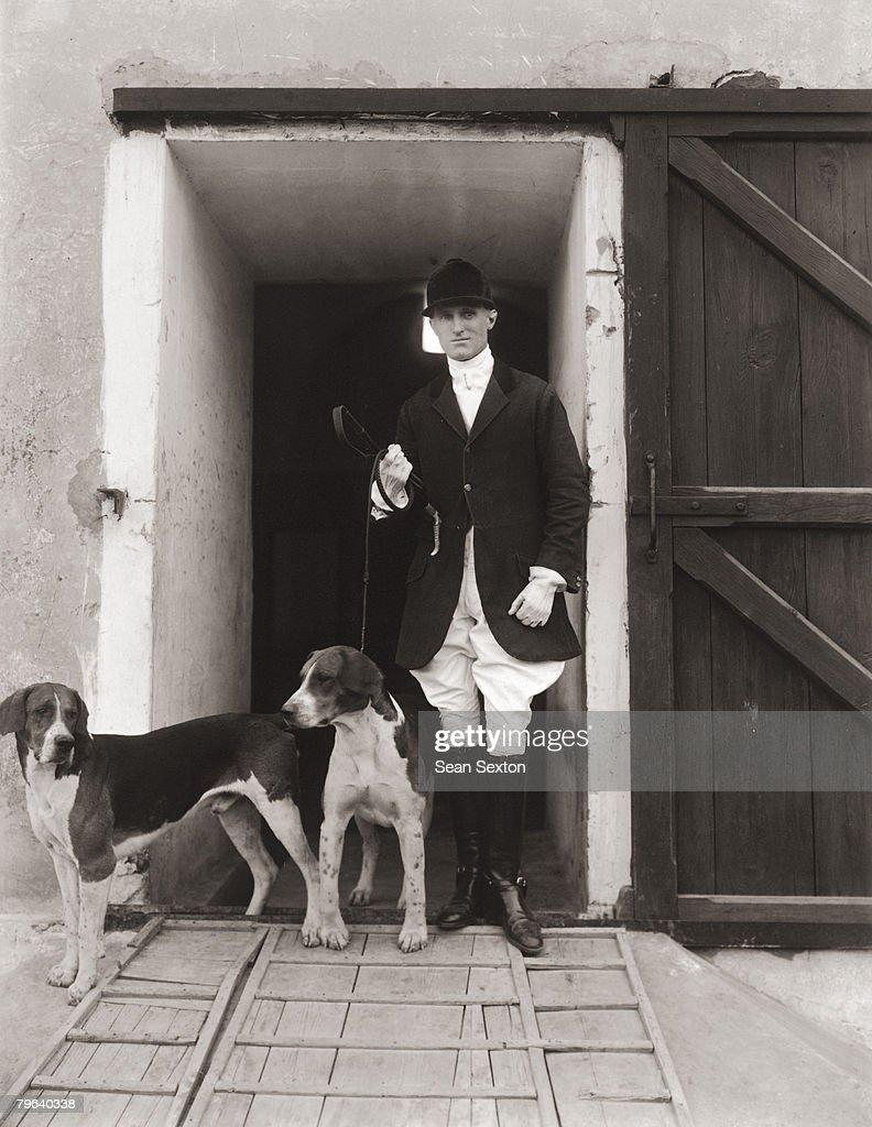 A huntsman with two hounds circa 1900