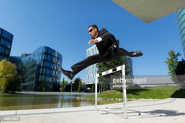 hurdler in business suit