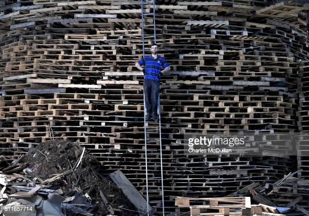 'Hurka' the chief architect and builder of the Craigyhill bonfire takes a break from stacking pallets to pose with his creation whilst balancing on a...