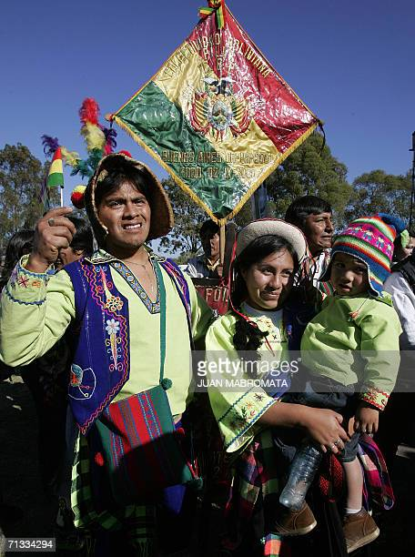 A family of Bolivian immigrants in Argentina dressed with indigenous clothes try to see closer they President Evo Morales at the end of a rally and...