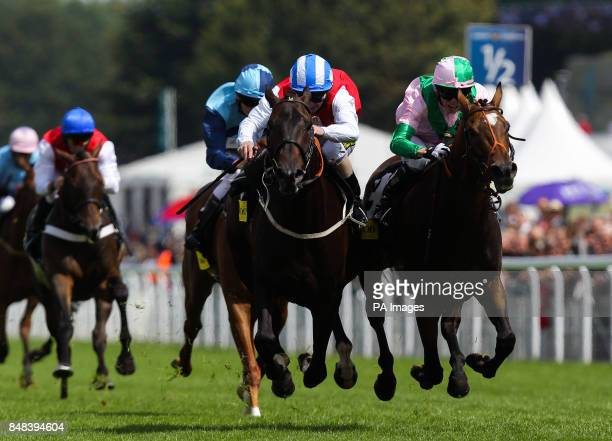 Hurricaine Higgins ridden by Joe Fanning comes home to win The Goodwood Stakes from Defence of Duress ridden by Jamie Spencer during QIPCO Sussex...